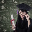 Asian female graduate in class with certificate — Stock Photo