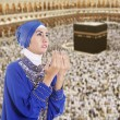 Stock Photo: Beautiful muslim womin blue at Kaaba, Saudi Arabia