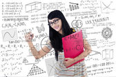 Beautiful female student write on transparent white board — Stock Photo