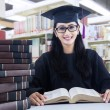 Stock Photo: Diligent student in library