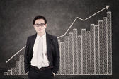 Businessman and growing bar chart — Stock Photo