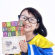 Asian girl bring wooden alphabet cube - isolated — Zdjęcie stockowe