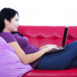 Attractive female typing on laptop - isolated — Stock Photo #28244899
