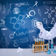 Beautiful scientist drawing on blue background — Stock Photo