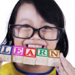 Close-up girl hold learn wood toy - isolated — Stock Photo