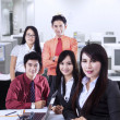 Confident business team at office — 图库照片