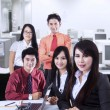 Confident business team at office — Stockfoto #28247397