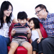 Excited family playing game on internet - isolated — Stock Photo