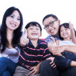 Happy family give thumbs up - isolated — Photo