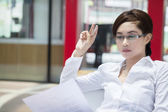 Beautiful pensive businesswoman at workplace — Stock Photo