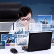 Busy businesswoman choosing pictures worldwide on laptop — Foto de Stock