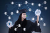 Asian female graduate networking touchscreen — Stock Photo