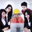 Asian contractor explaining to team at office — Stock Photo