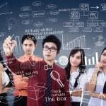 Business team leader explains plan on blue — Stock Photo