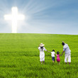 Christian family on green field — Stock Photo #28653893