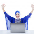 Happy female muslim and laptop - isolated — Zdjęcie stockowe