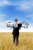 Businessman looking at online photos outdoor — Stock Photo
