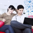 Asian couple surfing internet - indoor — Stock Photo