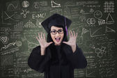 Excited female graduate and written board — ストック写真