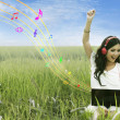 Stock Photo: Happy woman singing on field