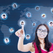 Attractive female student connect to social network — Stock Photo