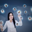 Businesswoman connects to team members digitally — Stock Photo
