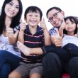 Isolated asian family showing thumbs up — Stock fotografie