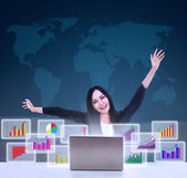 Happy businesswoman with bar graphs — 图库照片