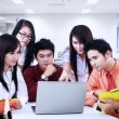 Stock Photo: Business team discussion on laptop at office