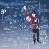 Uomo d'affari sta scrivendo la formula business di successo — Foto Stock