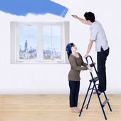Couple painting new room — Stock Photo