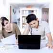 Stress couple paying bill online at home — Stock Photo #30228217