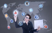 Businesswoman holding laptop click on social network — Stok fotoğraf