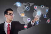 Businessman click on social network icon — Stockfoto