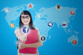 Asian female connects to social network — Stockfoto