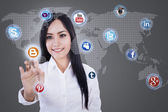 Businesswoman clicks on social network icon — Stockfoto
