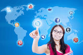 Beautiful student connects to social network — Foto de Stock