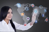 Close-up businesswoman connects to social network — Stock Photo