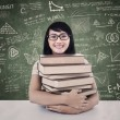 College student with books in class — Foto Stock