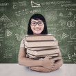 College student with books in class — Stok fotoğraf
