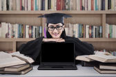 Graduate student with copy space on laptop — Stockfoto