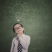 Smart businessman and drawn bulb — Foto Stock