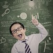 Little businessman has idea in class — Stock Photo