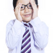 Shy expression of little businessman - isolated — Stock Photo