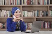Beautiful muslim girl at library — Stock Photo