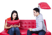 Asian young couple fighting with pillows — Stock Photo