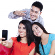 Three teenagers take a picture — Stock Photo