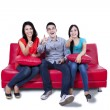 Three young friends pointing at the camera — Stock Photo