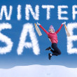 Asian woman jumping make the word winter sale — Stock Photo #31230201