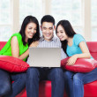 Friends with laptop — Stock Photo #31230487